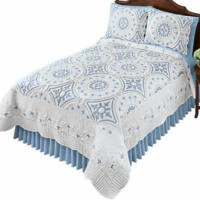 embroidered blue and grey medallion pattern quilt